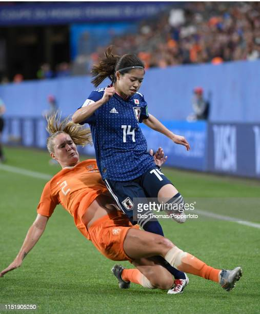 Yui Hasegawa of Japan is tackled by Desiree Van Lunteren of the Netherlands during the 2019 FIFA Women's World Cup France Round of 16 match between...