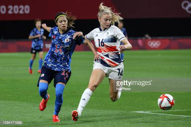 Yui HASEGAWA of Team Japan is challenged by Leah WILLIAMSON of Team Great Britain during the Women's First Round Group E match between Japan and...