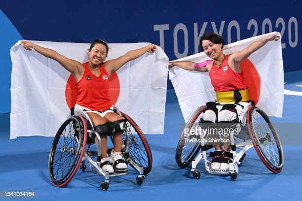 Yui Kamiji and Momoko Otani of Team Japan celebrate winning the bronze medal after their victory in the Wheelchair Tennis Women's Doubles Bronze...