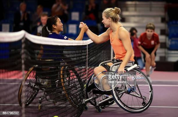 Yui Kamiji of Japan and Diede De Groot of The Netherlands shake hands following the womens final on day five of The NEC Wheelchair Tennis Masters at...