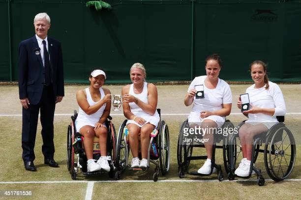 Yui Kamiji of Japan and Jordanne Whiley of Great Britain and runners up Jiske Griffioen and Aniek Van Koot of Netherlands pose with their trophies...