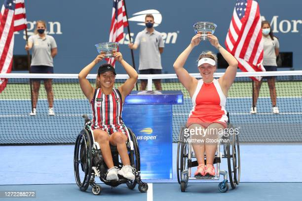 Yui Kamiji of Japan and Jordanne Whiley of Great Britain celebrate with their championship trophies after winning their Wheelchair Women's Doubles...