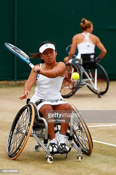 Yui Kamiji of Japan in action with Jordanne Whiley of Great Britain in the Wheelchair Ladies Doubles Final against Jiske Griffioen and Aniek Van Koot...