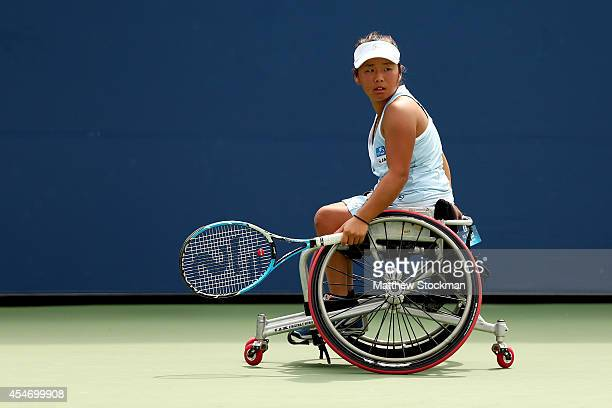 Yui Kamiji of Japan looks to return a shot against Jiske Griffioen of the Netherlands during their wheelchair women's singles semifinal match on Day...