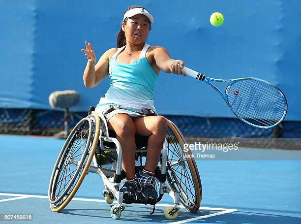 Yui Kamiji of Japan plays a forehand in her match with Marjolein Buis of the Netherlands against Jiske Griffioen of Netherlands and Aniek Van Koot of...