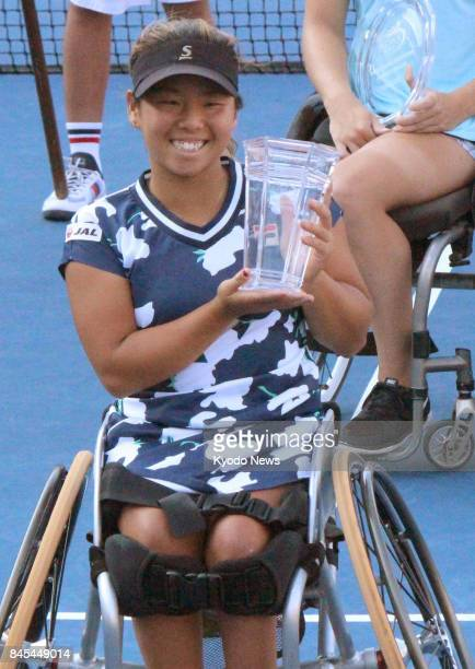 Yui Kamiji of Japan poses with the winner's trophy after winning the women's singles final against Diede de Groot of the Netherlands at the US Open...