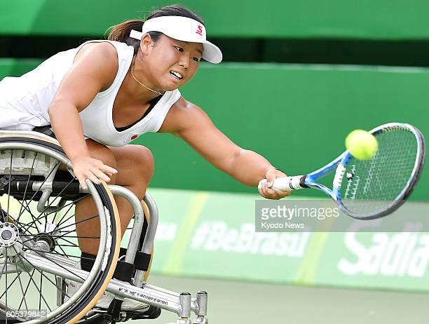 Yui Kamiji of Japan returns a shot against Aniek Van Koot of the Netherlands in the women's wheelchair tennis singles semifinals at the Rio de...