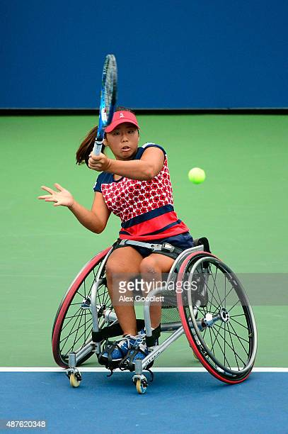 Yui Kamiji of Japan returns a shot to Marjolein Buis of the Netherlands in their Women's Wheelchair Singles Quarterfinals match on Day Eleven of the...
