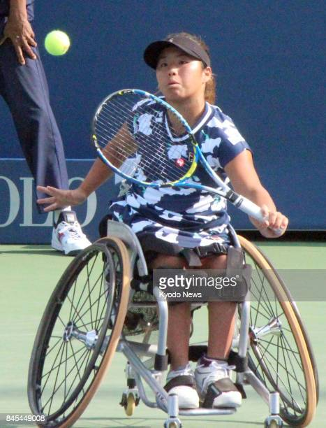 Yui Kamiji of Japan returns the ball to Diede de Groot of the Netherlands in the women's singles final at the US Open wheelchair championships in New...