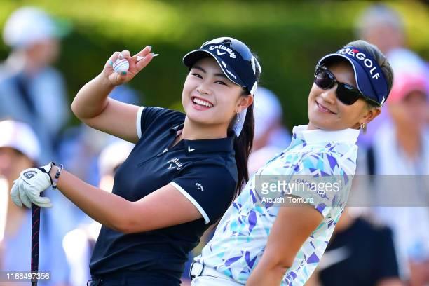 Yui Kawamoto and Misuzu Narita of Japan pose for photographers on the 10th tee during the second round of Karuizawa 72 Golf Tournament at Karuizawa...