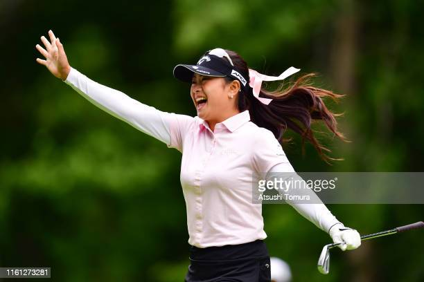 Yui Kawamoto of Japan celebrates after making a holeinone on the 11th hole during the first round of the Nippon Ham Ladies Classic at Katsura Golf...