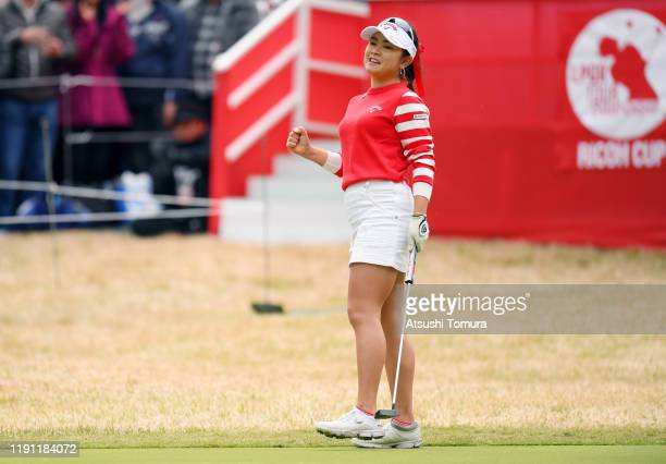 Yui Kawamoto of Japan celebrates holing out with the birdie on the 18th green during the final round of the LPGA Tour Championship Ricoh Cup at...