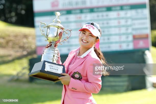 Yui Kawamoto of Japan celebrates on the 18th green after winning the Sanyo Shimbun Ladies Cup at Tojigaoka Marine Hills Golf Club on September 16...