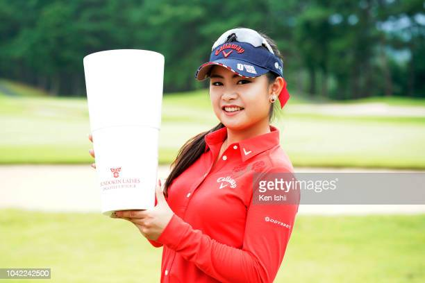 Yui Kawamoto of Japan holds the trophy after winning the Fundokin Ladies at Usuki Country Club on September 28 2018 in Usuki Oita Japan