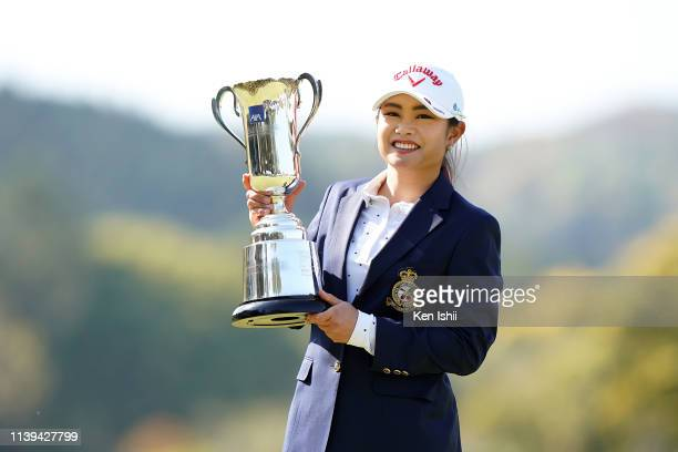 Yui Kawamoto of Japan holds the winner's trophy after winning the AXA Ladies Golf Tournament at the UMK Country Club on March 31 2019 in Miyazaki...