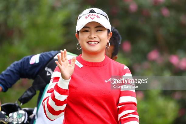 Yui Kawamoto of Japan poses after her tee shot on the 2nd hole during the final round of the LPGA Tour Championship Ricoh Cup at Miyazaki Country...