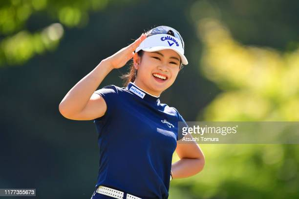 Yui Kawamoto of Japan poses for photographs after her tee shot on the 8th hole during the first round of the Miyagi TV Cup Dunlop Women's Open at...