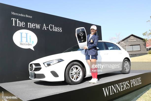 Yui Kawamoto of Japan poses for photos after winning the AXA Ladies Golf Tournament at the UMK Country Club on March 31 2019 in Miyazaki Japan