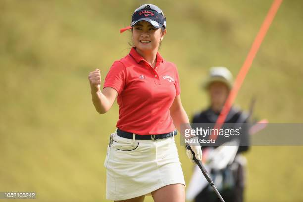 Yui Kawamoto of Japan reacts after her putt on the 18th green during the final round of the Udonken Ladies at Mannou Hills Country Club on October 14...