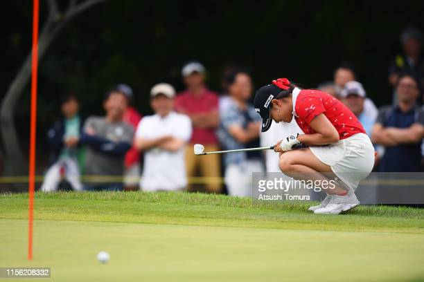 Yui Kawamoto of Japan reacts after missing a putt on the 15th green during the final round of the Ai Miyazato Suntory Ladies Open Golf Tournament at...