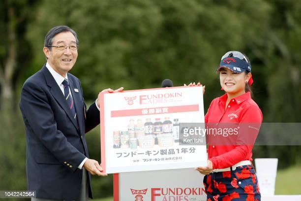 Yui Kawamoto of Japan receives winner's cheque after winning the Fundokin Ladies at Usuki Country Club on September 28 2018 in Usuki Oita Japan