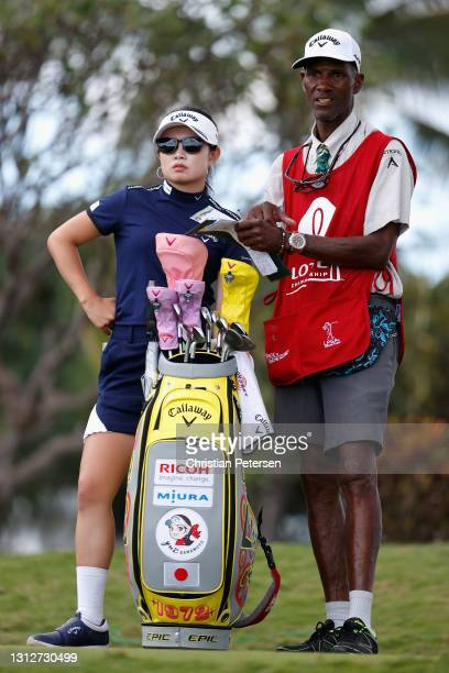 Yui Kawamoto of Japan talks with her caddie on the 12th hole during the second round of the LPGA LOTTE Championship at Kapolei Golf Club on April 15,...