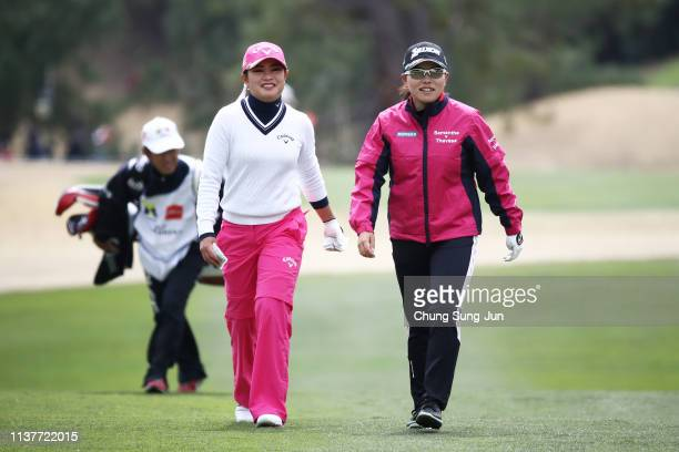 Yui Kawamoto of Japan talks with Minami Katsu of Japan on the 9th hole during the second round of the TPoint x ENEOS Golf Tournament at Ibaraki...