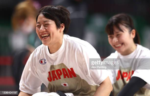Yui Kitama and Rie Odajima of Team Japan share a joke during the Wheelchair Basketball Women's preliminary round group A match between team Japan and...