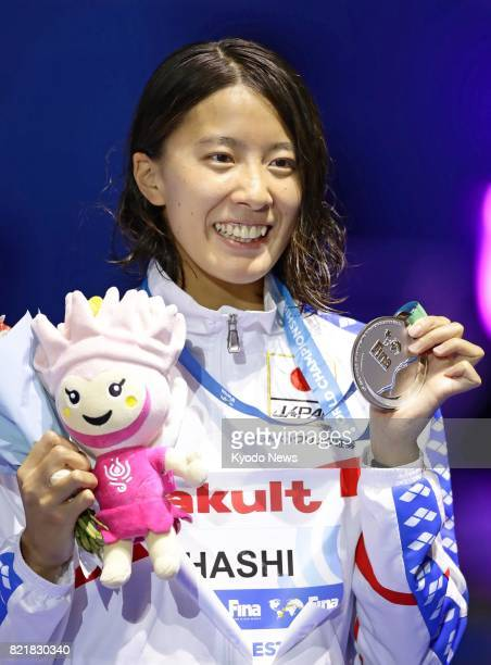 Yui Ohashi acknowledges the crowd during an award ceremony after winning the silver in the women's 200 meters individual medley in a new Japanese...
