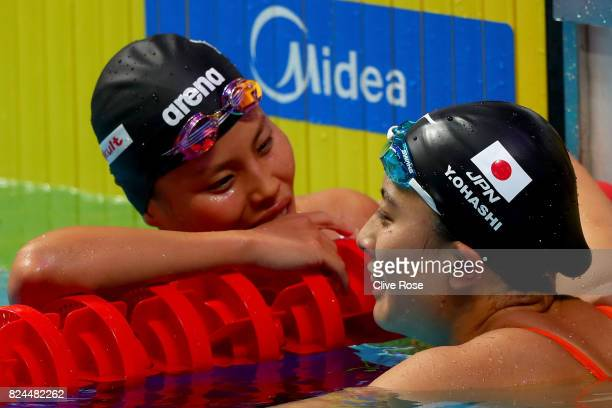 Yui Ohashi of Japan and Sakiko Shimizu of Japan speak after the Women's 400m Individual Medley on day seventeen of the Budapest 2017 FINA World...