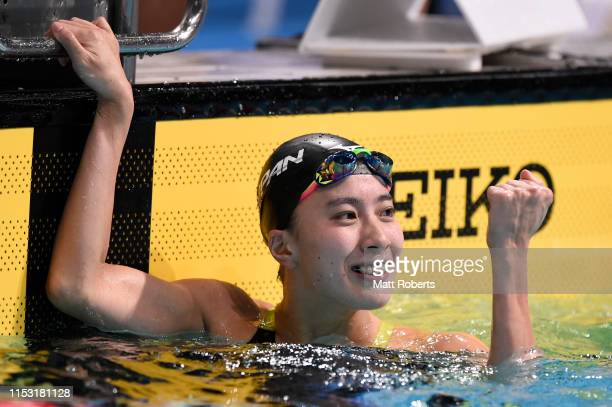 Yui Ohashi of Japan celebrates winning the Women's 100m Butterfly Final on day four of the Swimming Japan Open at the Tokyo Tatsumi International...