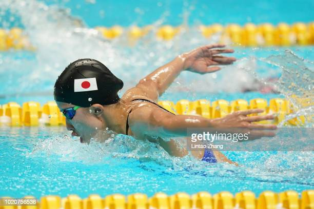 Yui Ohashi of Japan competes in the Swimming Women's 400m Individual Medley final at the GBK Aquatics Center on day three of the Asian Games on...