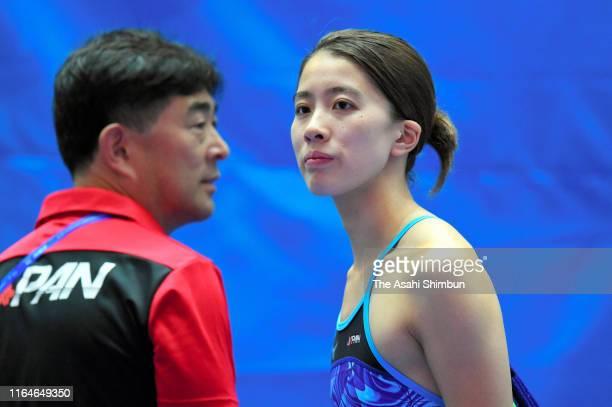 Yui Ohashi of Japan talks with head coach Norimasa Hirai ahead of the Gwangju 2019 FINA World Championships at Nambu International Aquatics Centre on...