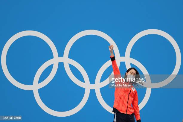 Yui Ohashi of Team Japan celebrates after winning the gold medal during the medal ceremony for the Women's 200m Individual Medley Final on day five...