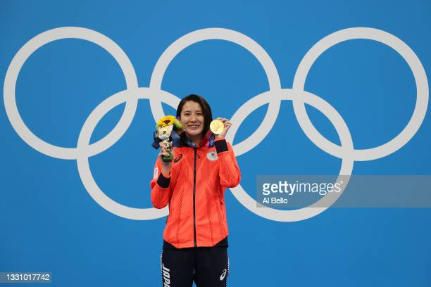 Yui Ohashi of Team Japan poses with the gold medal during the medal ceremony for the Women's 200m Individual Medley Final on day five of the Tokyo...