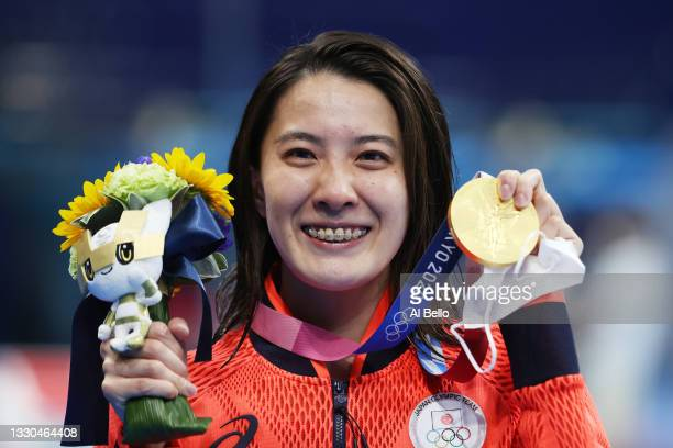 Yui Ohashi of Team Japan poses with the gold medal for the Women's 400m Individual Medley Final on day two of the Tokyo 2020 Olympic Games at Tokyo...