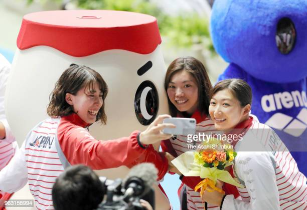 Yui Ohashi Reona Aoki and Rikako Ikee pose for selfie photographs after day four of the Swimming Japan Open at Tokyo Tatsumi International Swimming...