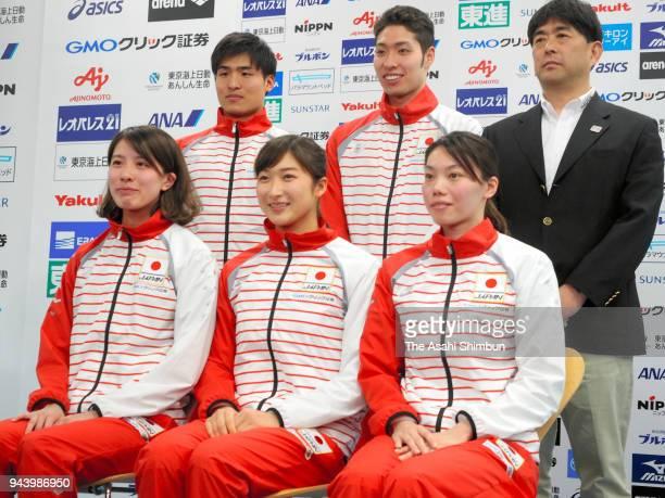 Yui Ohashi Rikako Ikee and Reona Aoki Nao Horomura Kosuke Hagino and head coach Norimasa Hirai pose for photographs during a press conference on...