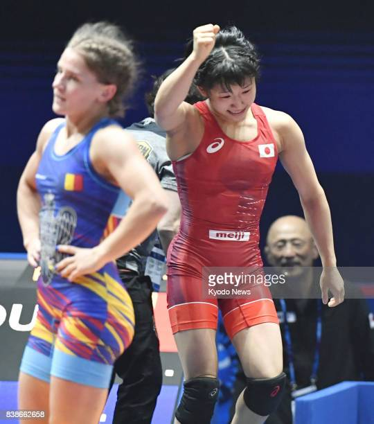 Yui Susaki of Japan raises her fist after winning the women's 48kilogram final against Emilia Alina Vuc of Romania at the world wrestling...
