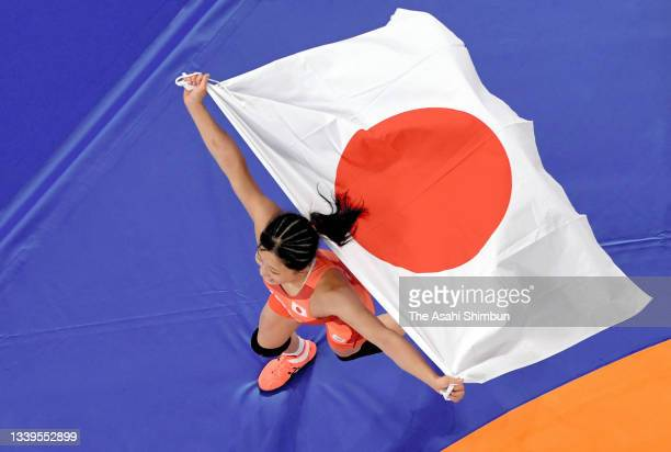 Yui Susaki of Team Japan celebrates winning the gold medal after her victory in the Women's Freestyle 50kg final against Sun Yanan of Team China on...