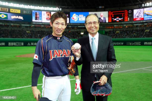 Yuichi Honda of Team Japan poses with Sadaharu Oh before the Pool A Game 1 between Team Japan and Team Brazil during the first round of the 2013...