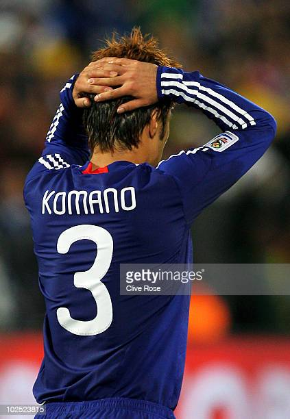 Yuichi Komano of Japan is dejected after missing in a penalty shootout during the 2010 FIFA World Cup South Africa Round of Sixteen match between...