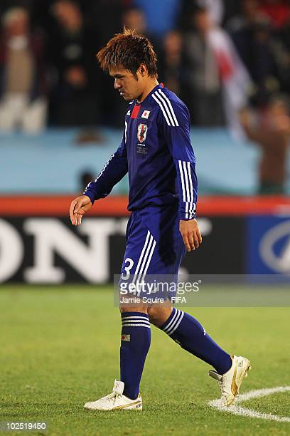 Yuichi Komano of Japan looks dejected after missing a penalty during the 2010 FIFA World Cup South Africa Round of Sixteen match between Paraguay and...