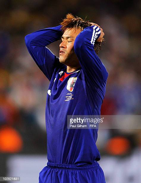 Yuichi Komano of Japan reacts after missing a penalty during the 2010 FIFA World Cup South Africa Round of Sixteen match between Paraguay and Japan...