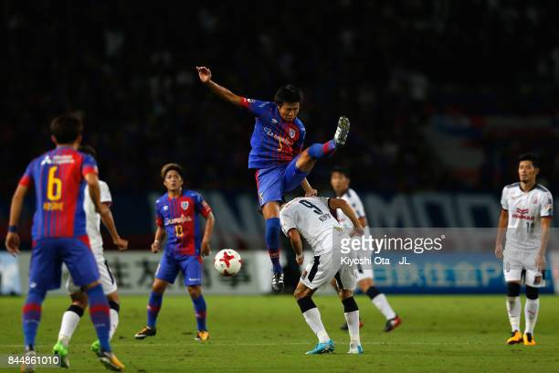 Yuichi Maruyama of FC Tokyo and Kenyu Sugimoto of Cerezo Osaka compete for the ball during the JLeague J1 match between FC Tokyo and Cerezo Osaka at...