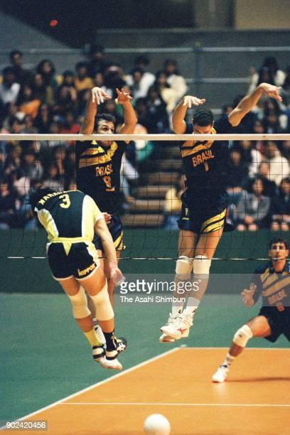 Yuichi Nakagaichi of Japan is blocked during the World Super Volleyball match between Japan and Brazil at the Yoyogi National Gymnasium on November...