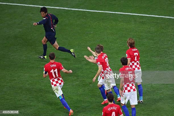 Yuichi Nishimura awards a penalty kick as Darijo Srna, Sime Vrsaljko, Luka Modric, Vedran Corluka and Ivan Rakitic of Croatia pursue him during the...