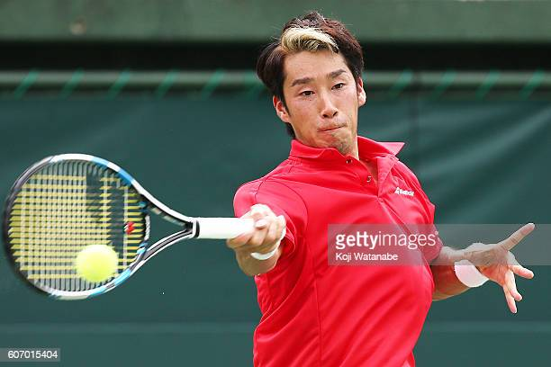 Yuichi Sugita and Kei Nishikori of Japan competes against Sergiy Stakhovsky and Artem Smirnov of Ukraine during the Davis Cup World Group Playoff...