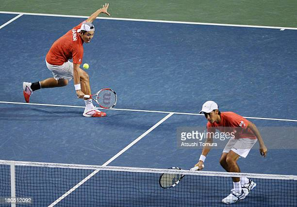 Yuichi Sugita and Tatsuma Ito of Japan return a shot in the doubles game against Alejandro Falla and JuanSebastian Cabal of Colombia during day two...