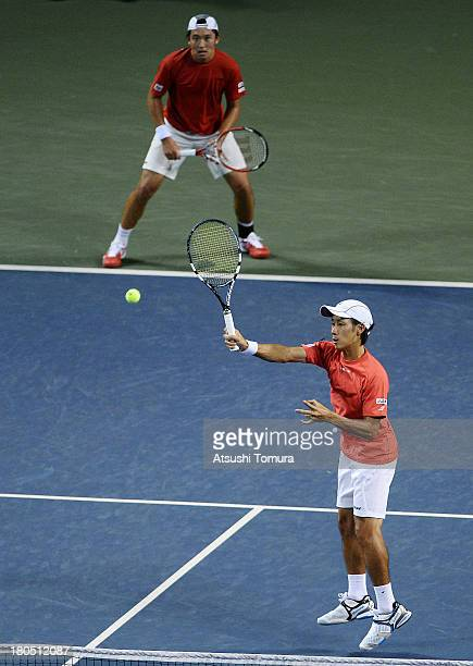 Yuichi Sugita and Tatsuma Ito of Japan returns a shot in the doubles game against Alejandro Falla and JuanSebastian Cabal of Colombia during day two...